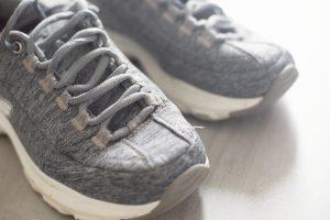 sneakers on grey tile
