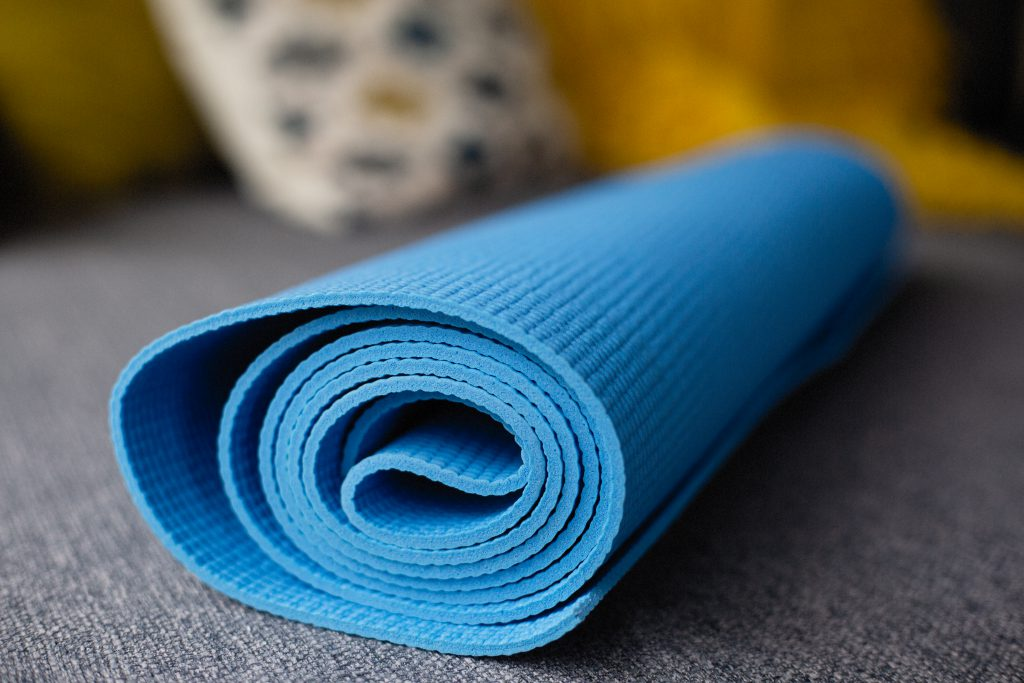 Blue Yoga Mat on a Couch