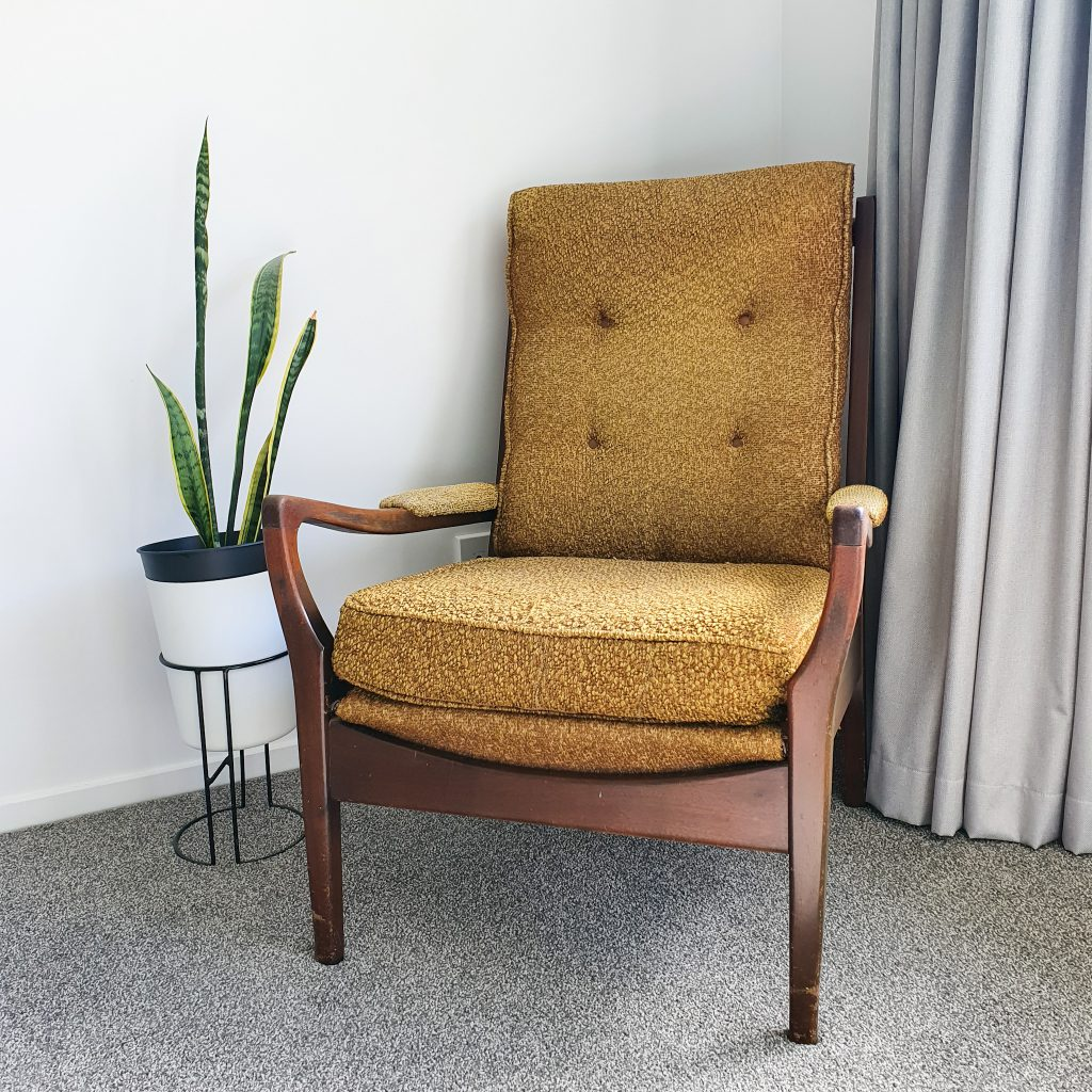 chair in corner and pot plant