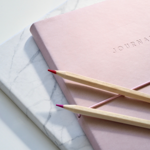 two journals and two pencils