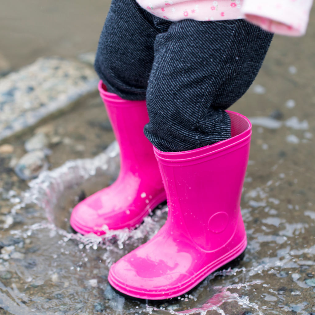 image of gumboots in puddle